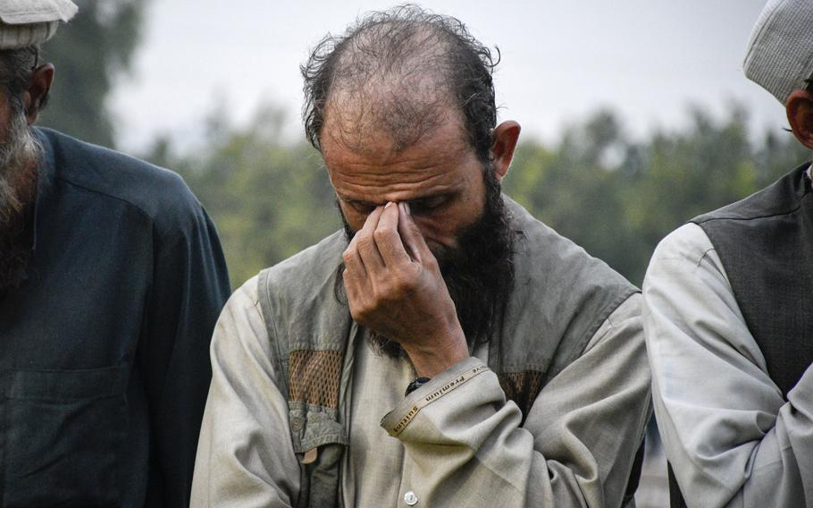 A fighter for Islamic State lines up Nov. 19, 2019 in Jalalabad, Afghanistan, after surrendering to the Afghan government. An estimated 2,000 ISIS fighters and their family members are expected to surrender after government offensives, supported by U.S. and coalition forces, cut off their supply lines.