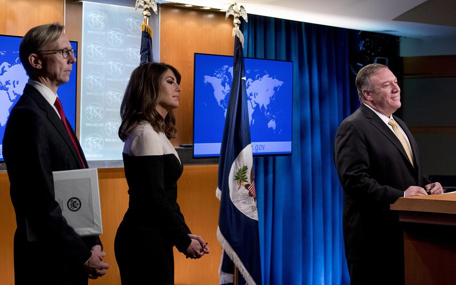 Secretary of State Mike Pompeo, right, accompanied by U.S. special representative on Iran Brian Hook, left, and State Department spokeswoman Morgan Ortagus, second from left, takes a question from a reporter during a news conference at the State Department in Washington, Monday, Nov. 18, 2019. Pompeo spoke about Iran, Iraq, Israeli settlements in the West Bank, protests in Hong Kong, and Bolivia, among other topics