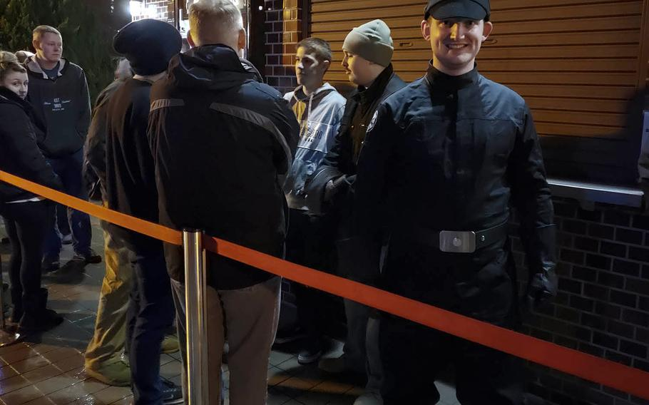 """Air Force Staff Sgt. Brandon Jacobs, dressed as an Imperial reserve officer, waits in line to see """"Star Wars: The Rise of Skywalker"""" at Yokota Air Base, Japan, Thursday, Dec. 19, 2019."""
