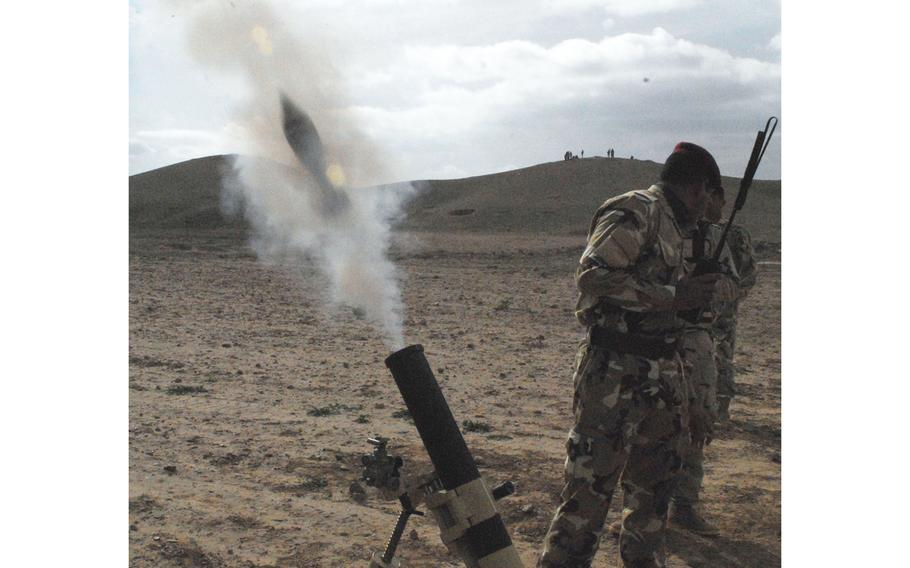 Iraqi army soldiers fire mortars during a live-fire exercise on Jan. 25, 2010, at K1 Base outside of Kirkuk, Iraq. A U.S. contractor was killed and other American and Iraqi service members were wounded Friday evening in a rocket attack at K1.