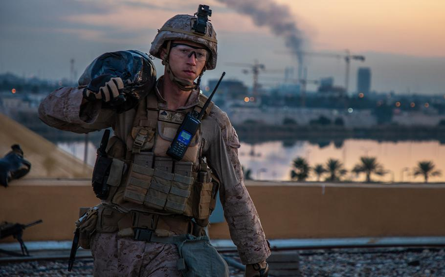 A U.S. Marine with 2nd Battalion, 7th Marines, assigned to the Special Purpose Marine Air-Ground Task Force-Crisis Response-Central Command 19.2, carries a sandbag to strengthen a security post during the reinforcement of the Baghdad Embassy Compound in Iraq on Jan. 4, 2020.