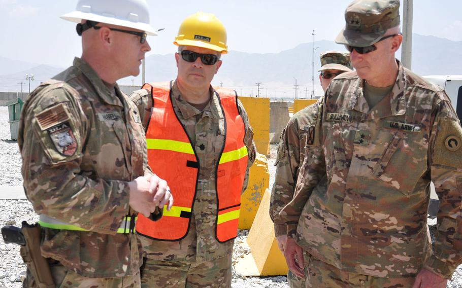 In an August, 2019 photo, Navy Cmdr. Robert Kurkjian (center), commander of the DLA Support Team – Afghanistan, listens as Navy Lt. Cmdr. Steve Harrell, officer in in charge of DLA Disposition Services-Afghanistan, briefs Army Maj. Gen. John Sullivan, new commander of the 1st Theater Sustainment Command.