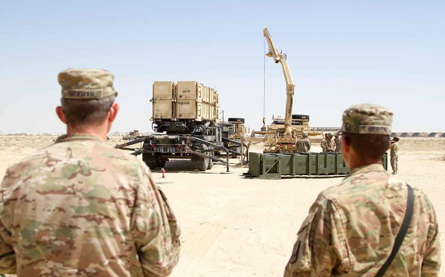 U.S. Army officials watch crews as they practice Patriot Missile Defense System reloading procedures during training in Kuwait on March 25, 2016.