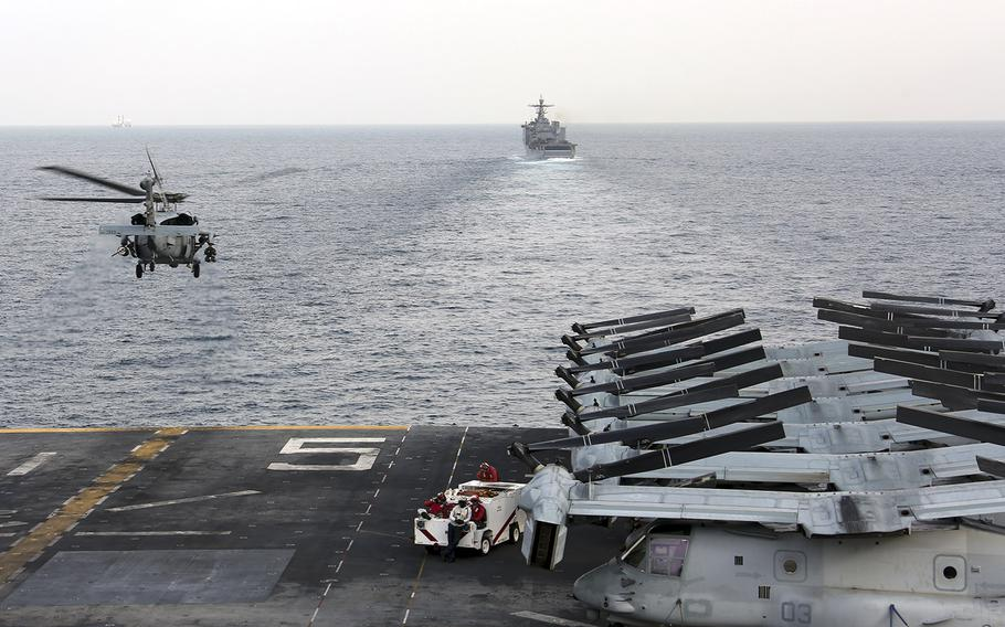 In a February 12, 2020 photo, a U.S. Navy MH-60S Sea Hawk helicopter departs from the amphibious assault ship USS Bataan (LHD 5) in the Strait of Hormuz.