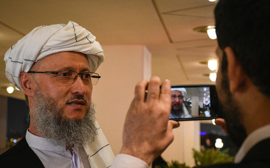 Taliban official Abdul Salam Hanafi speaks to reporters in Pashto and Dari on the eve of a historic agreement between the militant group and the United States in Doha, Qatar, Feb. 28, 2020.
