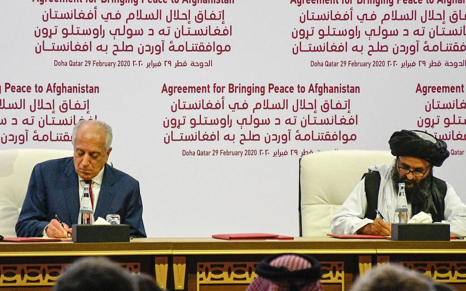 Zalmay Khalilzad, America's special envoy for Afghan reconciliation, signs a peace deal with the Taliban, along with Mullah Abdul Ghani Baradar, the militant group's top political leader, in Doha, Qatar, on Saturday, Feb. 29, 2020.