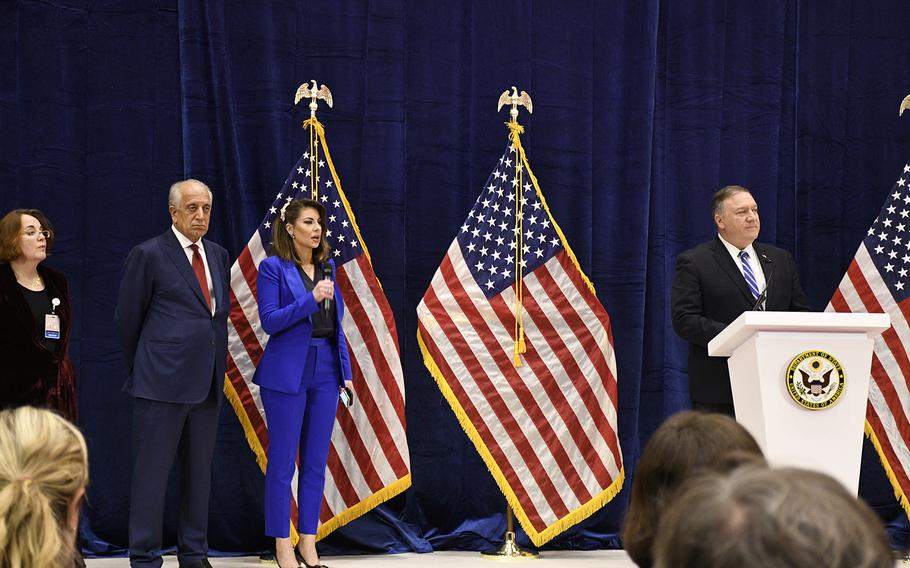 Secretary of State Mike Pompeo, right, takes questions from reporters while on stage with Zalmay Khalilzad, second from left, the U.S. special envoy for Afghan reconciliation, after a historic peace deal between the U.S. and the Taliban was signed Saturday,  Feb. 29, 2020, in Doha, Qatar.