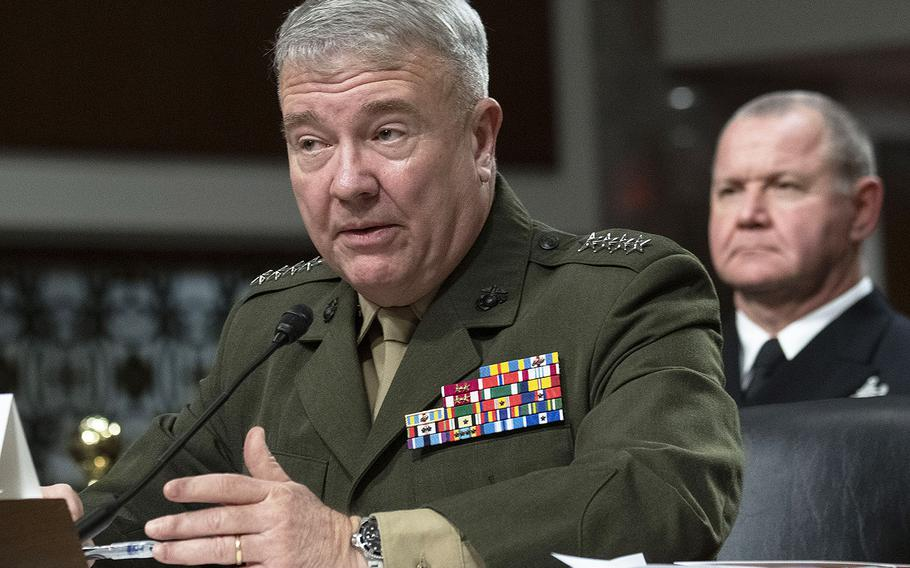 Gen. Kenneth F. McKenzie, Jr., commander of the United States Central Command, testifies at a Senate Armed Services Committee hearing on Capitol Hill, March 12, 2020. Behind him is Fleet Master Chief James Herdel, CENTCOM's senior enlisted leader.