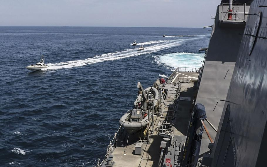Iranian Islamic Revolutionary Guard Corps Navy (IRGCN) vessels maneuver near U.S. military ships in the Persian Gulf, April 15, 2020.