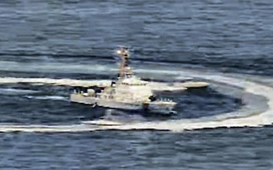 A screen capture from a video shows Iranian boats maneuvering near a U.S. ship in the Persian Gulf, April 15, 2020.
