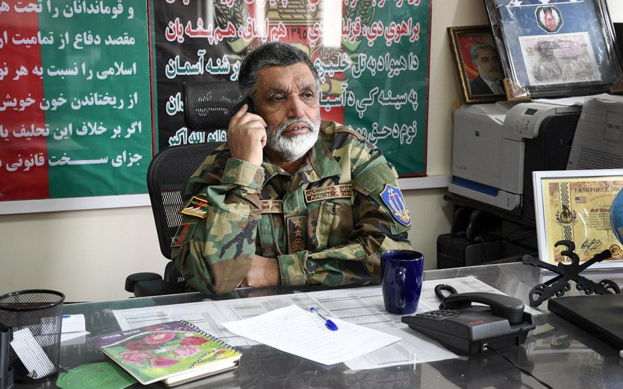 Brig. Gen. Abdul Raziq, then-commander of the Afghan army's 4th Brigade, 203rd Corps, answers calls prior to a meeting with American advisers on Jan. 14, 2019 at Camp Maiwand in Logar province, Afghanistan. U.S. Army Command Sgt. Maj. Timothy Bolyard was killed in an insider attack in September 2018 after meeting with Raziq at Camp Maiwand.