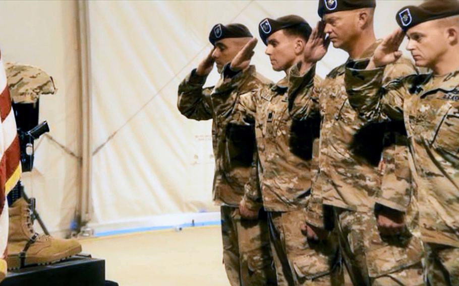 Soldiers of the 1st Security Force Assistance Brigade honor fallen Command Sgt. Maj. Timothy Bolyard, who was killed in an insider attack in Sept.2018, at a memorial ceremony in Afghanistan.