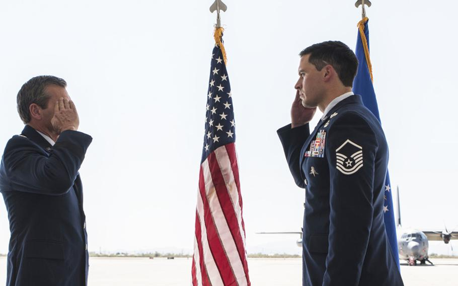 U.S. Air Force Maj. Gen. Barry Cornish, 12th Air Force commander, returns the salute of Master Sgt. Adam Fagan, 48th Rescue Squadron pararescueman, during a Bronze Star presentation ceremony at Davis-Monthan Air Force Base, Ariz., Oct. 1, 2020. Fagan was presented the Bronze Star Medal with valor for his actions during a mission last year in Afghanistan.