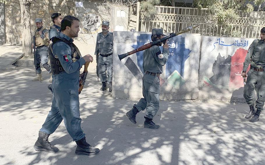 Afghan police arrive at the site of an attack at Kabul University in Kabul, Afghanistan, Monday, Nov. 2, 2020. Gunfire erupted at the university in the Afghan capital early Monday and police have surrounded the sprawling campus, authorities said.