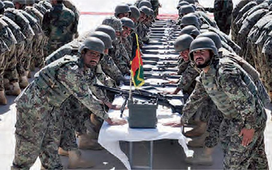 215th Corps soldiers of the Afghan National Army graduate from their training program in Helmand Province in in October 2020.