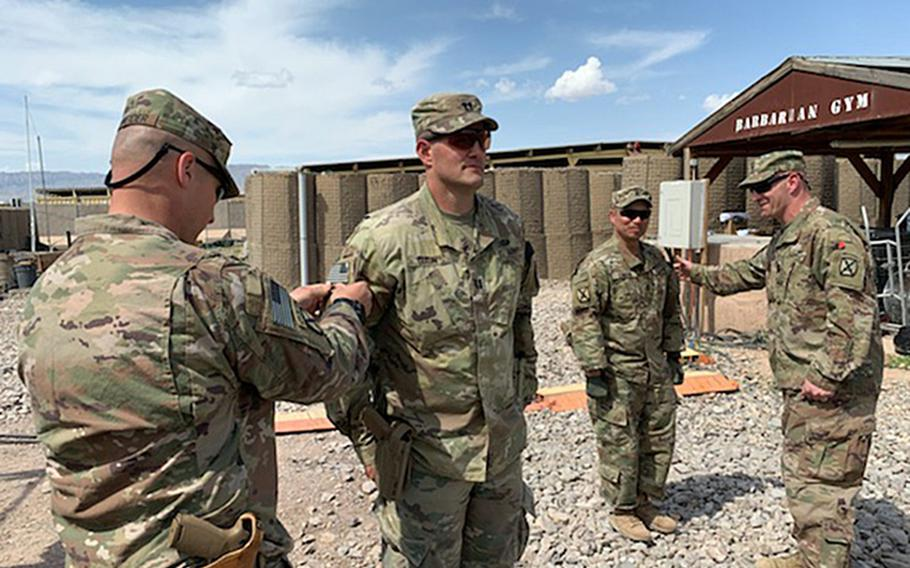 Capt. Matthew Dixon, who deployed with the 1st Battalion, 87th Infantry of the 10th Mountain Division, receives a combat patch during his deployment to Afghanistan during the spring of 2020. Dixon's deployment was cut short after the U.S. agreed to withdraw troops from the country under a deal signed with the Taliban in February.
