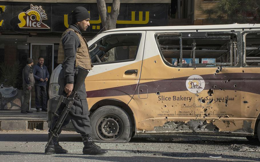 An Afghan security official patrols a section of road in the Shar-e-Now area of Kabul, which was hit by rockets on Saturday, Nov. 21, 2020.