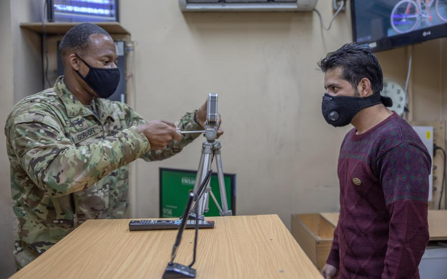 Army Staff Sgt. Dewayne Gordon, left, is pictured at Resolute Support headquarters in Kabul on Wednesday, Nov. 25, 2020. The father of three says the coronavirus pandemic has given everyone ''a little more perspective.''