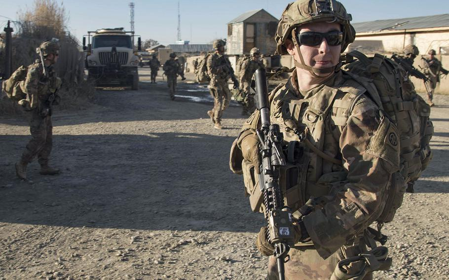 Paratroopers from the 82nd Airborne Division ensure the area is secure during a fly-to-advise mission in southeastern Afghanistan in December 2019. A measure has been included in the final version of the defense bill to prevent the further withdrawal of U.S. forces from Afghanistan without input from the Pentagon and other government agencies.
