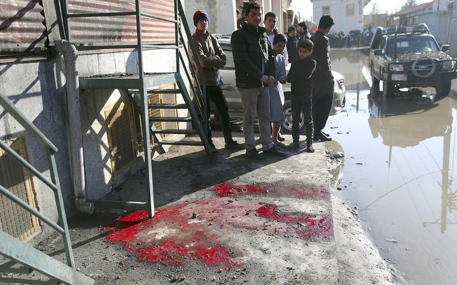 Blood stains are seen on the ground after a rocket in Kabul, Afghanistan, Saturday, Dec. 12, 2020. An early morning barrage slammed into the Afghan capital, an Interior Ministry spokesman said.