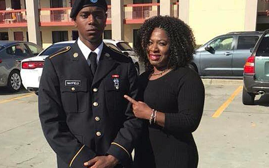 Spc. Henry Mayfield Jr., seen here with his mother Carmoneta Horton-Mayfield, was among three Americans killed on Jan. 5, 2020, at Manda Bay Airfield in southwest Kenya when the base was attacked by insurgents connected to the Somalia-based al-Shabab terrorist group. Defense Department contractors Dustin Harrison, 47, and Bruce Triplett, 64, also died in the attack.