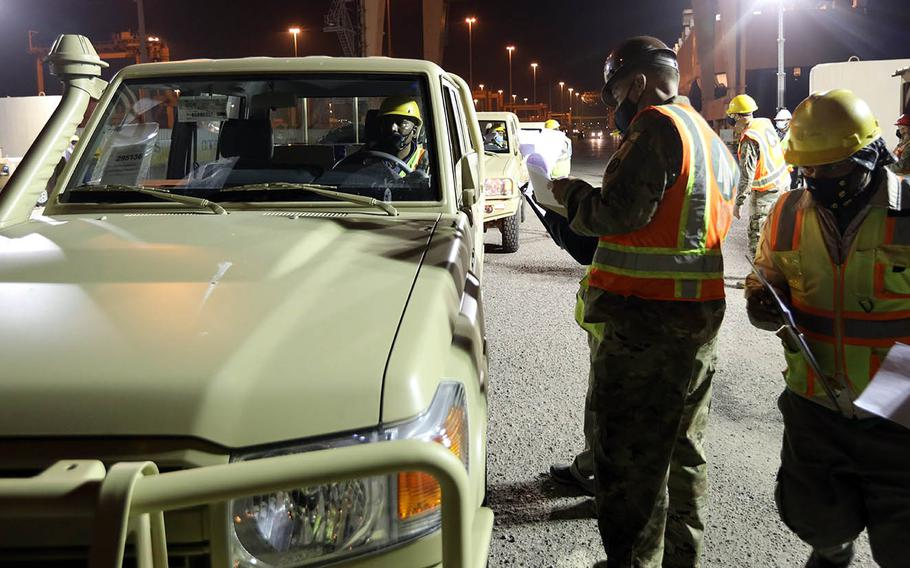Vehicles are offloaded at Port of Shuaiba, Kuwait, Dec. 10, 2020, by U.S. Army personnel for eventual distribution to Iraqi Security Forces.
