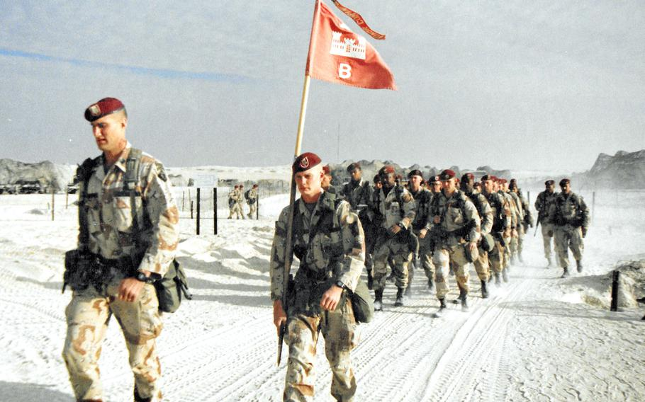 Soldiers with Bravo Company, 27th Engineer Battalion, march on Christmas Day, 1990 during Operation Desert Shield in Saudi Arabia.