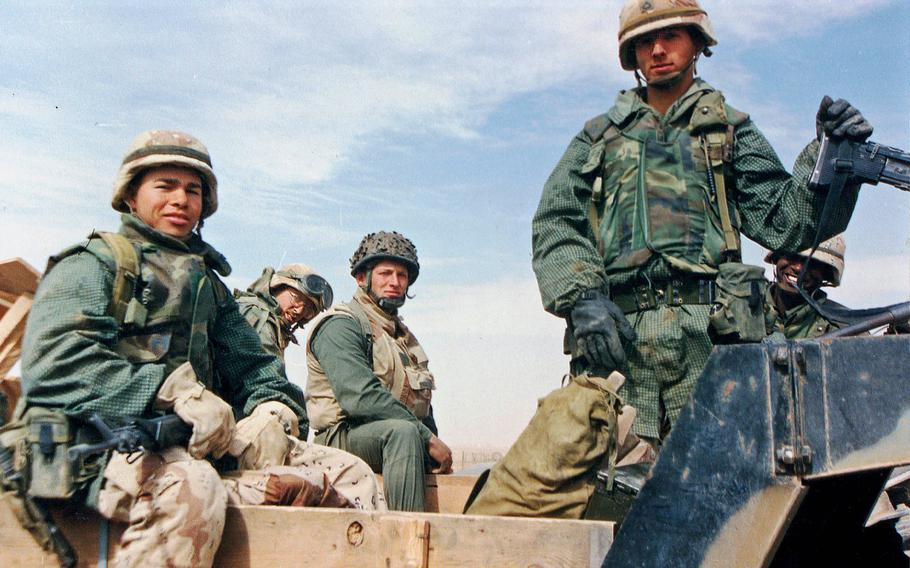 A group of U.S. soldiers pose during Operation Desert Storm in 1991.