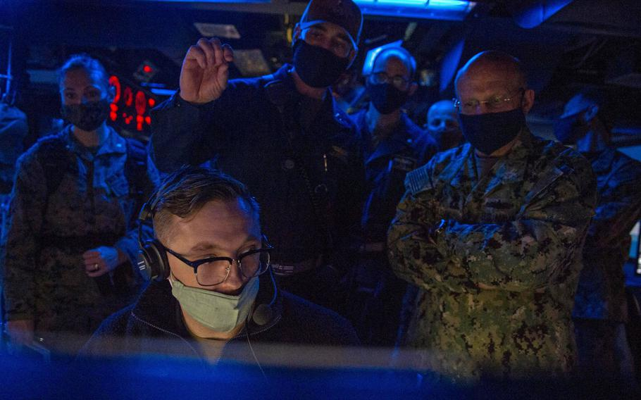 Adm. Mike Gilday, chief of naval operations, visits the combat information center aboard the destroyer USS John Paul Jones in the Persian Gulf, Jan. 13, 2021.