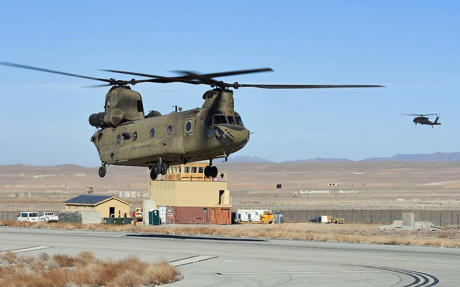 U.S. Army helicopters train at Camp Dahlke, Afghanistan, in December 2018. U.S. and NATO forces have left the base, formerly Forward Operating Base Shank, as the drawdown of U.S. troops in the country continues. Troop levels in Afghanistan are now at a 19-year low, President Donald Trump said in a statement on Jan. 14, 2021.