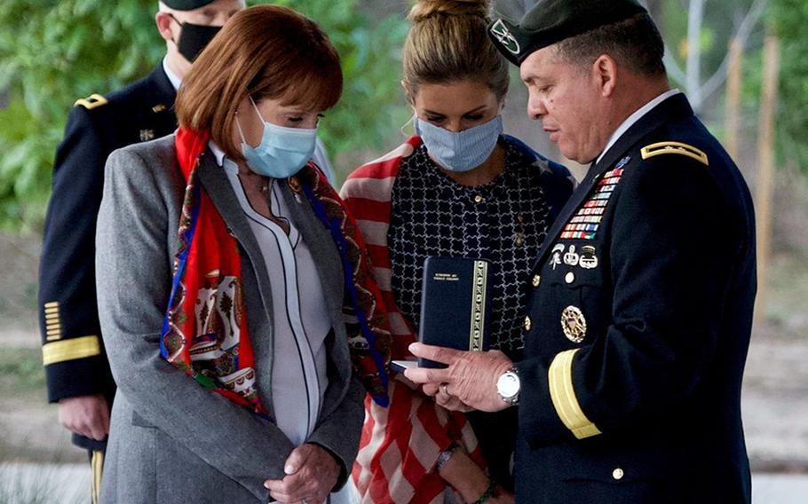 """Maj. Gen. Miguel Correa, right, presents the Silver Star Medal to Staff Sgt. James ''Jimmy"""" Moriarty's mother, Cynthia Moriarty, left, and sister, Becky Moriarty Davis, center, in Houston on Wednesday, Jan. 27, 2021."""