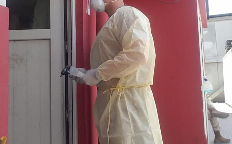 Air Force Master Sgt. Brandon Hockenbarger conducts door-to-door coronavirus testing for those in isolation at NATO Resolute Support Headquarters in Kabul, Afghanistan, sometime in 2020.