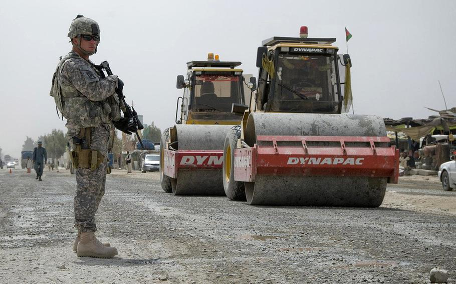 Sgt. Randy Elmore, 525th Battlefield Surveillance Brigade, secures a reconstruction project along Highway 4 in Spin Boldak, Afghanistan, in 2011. The construction was funded through the Commander's Emergency Response Program. Lawmakers have directed the military to stop the multibillion-dollar program.