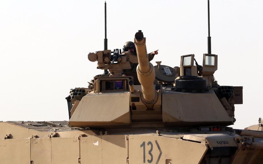 A U.S. soldier from the Fort Bliss, Texas-based 1st Battalion, 6th Infantry Regiment, directs a neighboring tank during a training exercise with United Arab Emirates forces in Abu Dhabi, UAE, on Jan. 30, 2021.