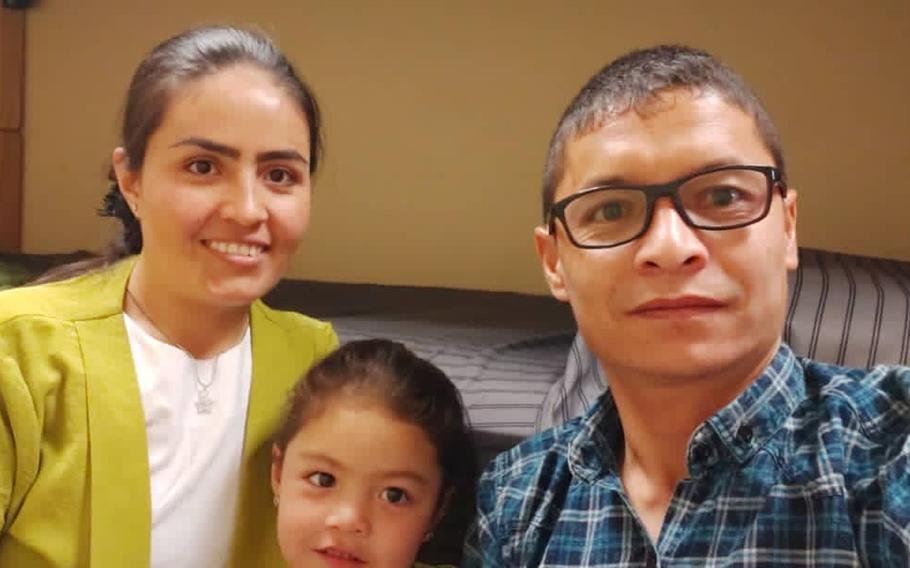 Maj. Mohammed Naiem Asadi, his wife Rahima and their daughter Zainab, 4, in a photo taken Oct. 30, 2020, stayed at Bagram Airfield for several weeks before being told to leave. Asadi and his family have reapplied for refuge in the United States while in hiding.