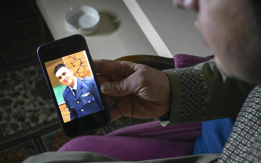 Bashir Ahmad Vesa mourns the death of his brother, Massoud Atal, an Afghan pilot shot by gunmen in Kabul, Afghanistan on Dec. 30, 2020. Vesa keeps photos of his younger brother to keep his memory alive, he said on Jan. 21, 2021.
