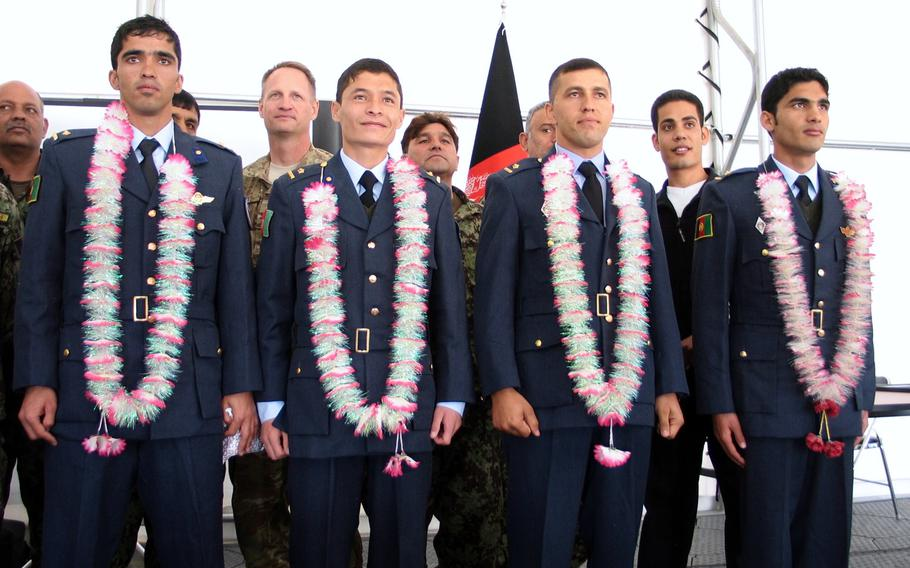 Mohammed Naiem Asadi, first row, second from left,  graduates flight school Jan. 27, 2013 after receiving training from American instructors. Asadi, now an Afghan air force major, has reapplied for refuge in the United States while in hiding.
