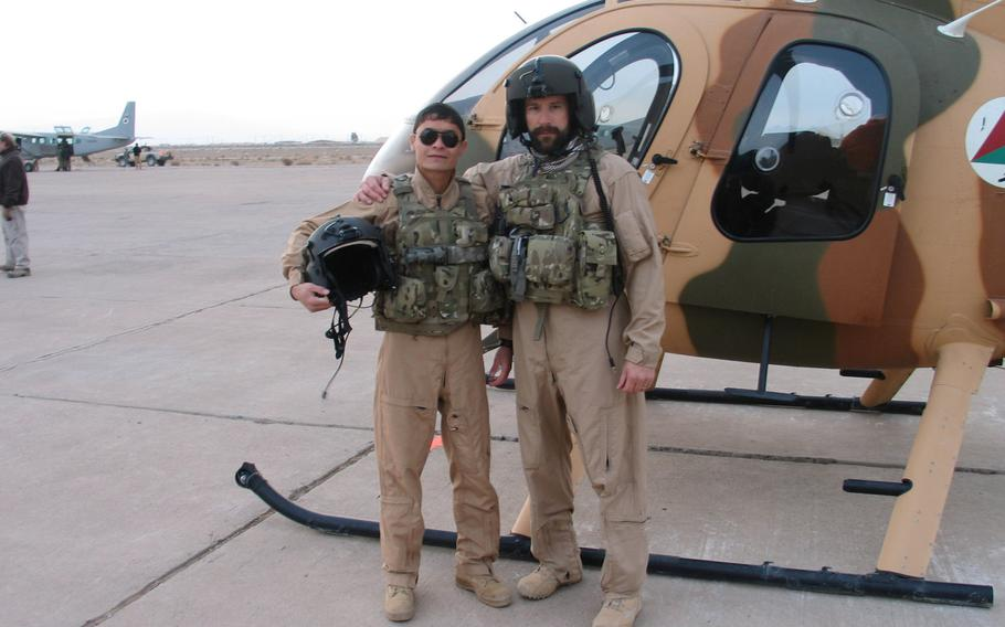 Mohammed Naiem Asadi poses with an instructor during flight training Jan. 7, 2013 in Afghanistan. Asadi, now an Afghan air force major, has reapplied for refuge in the United States while in hiding.