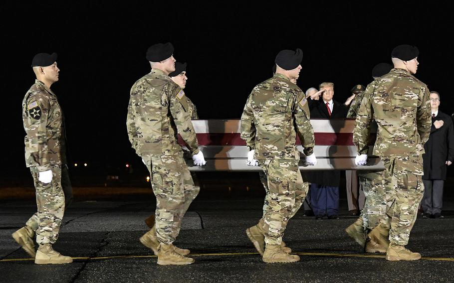 A U.S. Army carry team transfers the remains of Sgt. 1st Class Javier J. Gutierrez, of San Antonio, Texas, at Dover Air Force Base, Del., Feb. 10, 2020. Gutierrez was killed in eastern Nangarhar province, Afghanistan, on Feb. 8, 2020, one of the last two American troops to die in combat in the country.