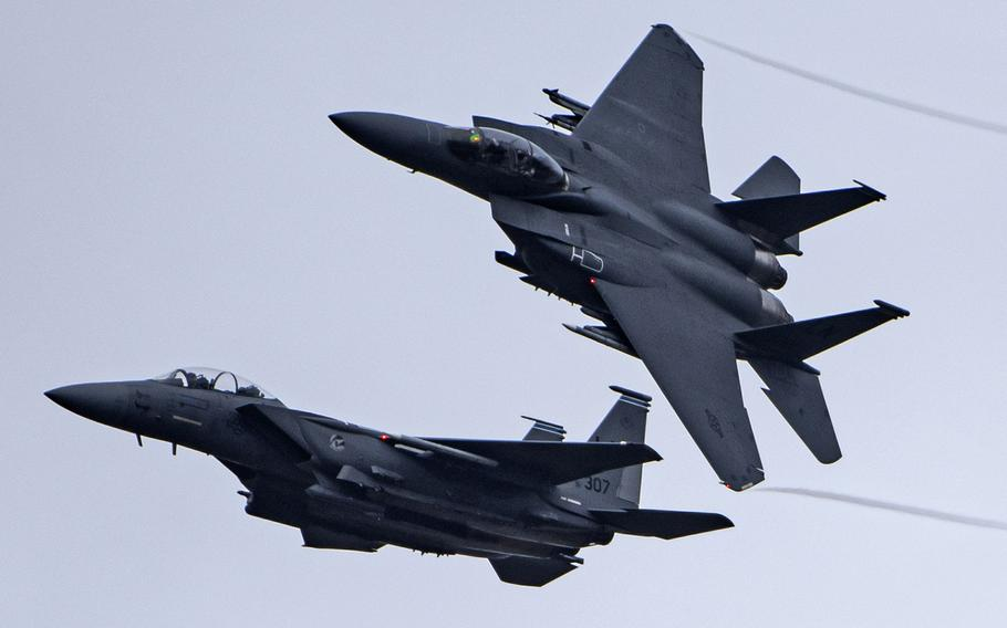 In a Feb. 19, 2021 photo, F-15E Strike Eagles assigned to the 492nd Fighter Squadron return from a training sortie at Royal Air Force Lakenheath, England. Similar aircraft conducted a raid on facilities in Syria used by Iranian-backed militias Thursday night.