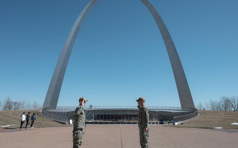Navy Counselor 1st Class Dalton Kotz, right, a recruiter assigned to Navy Talent Acquisition Group (NTAG) Mid America, reenlists in front of the Gateway Arch, Feb. 23, 2021.