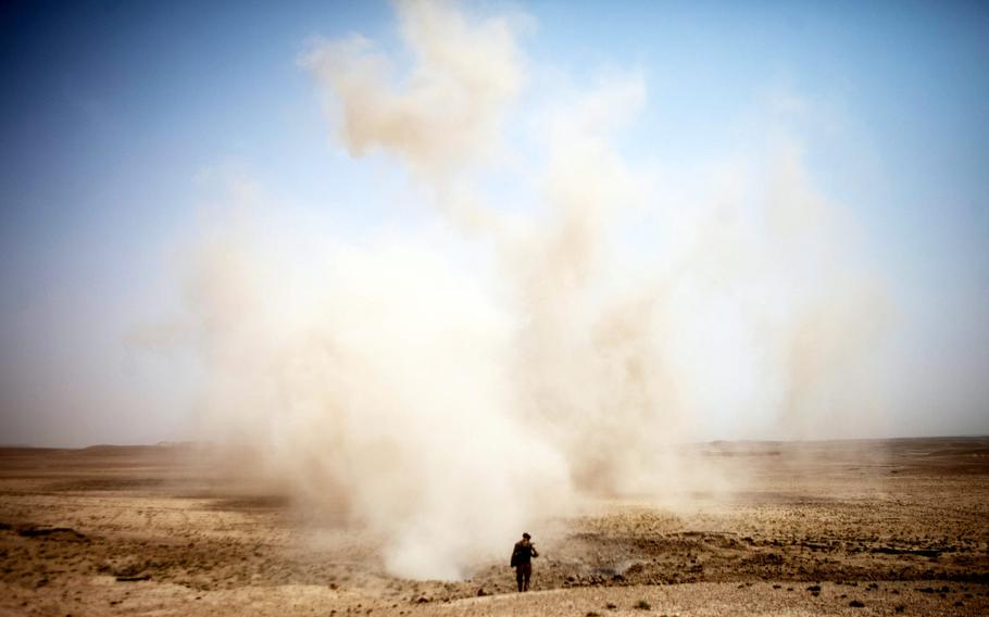 Marine Corps Sgt. Danny Ridgeway, with Regimental Combat Team 8, conducts a post-blast assessment shortly after the detonation of an explosives cache found in Sangin, Afghanistan, in 2011.  Even small explosions may change the molecular structure of the brain and increase the risk of Alzheimer's disease, Army-funded researchers said in a paper published by the journal Brain Pathology, Feb. 25, 2021.
