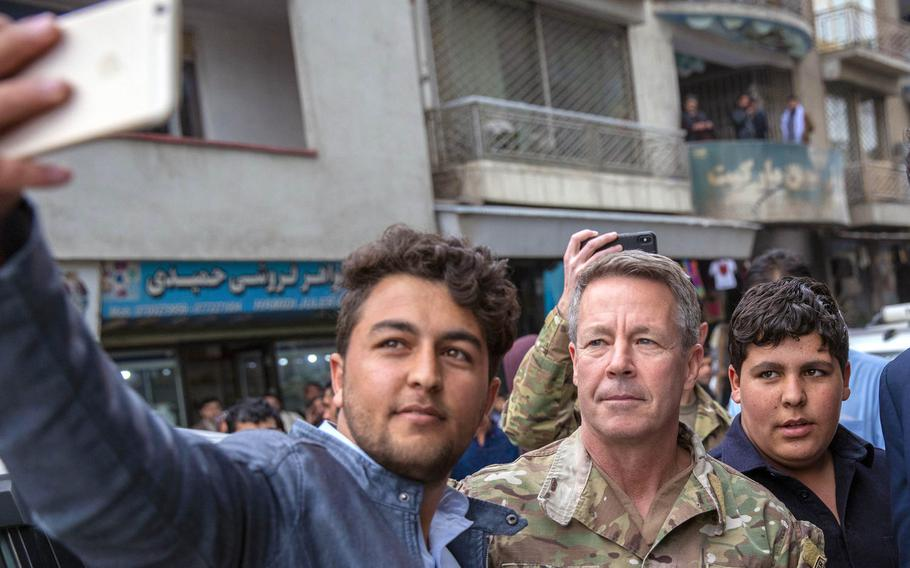 Resolute Support commander Gen. Scott Miller poses for a selfie with a resident in downtown Kabul, Afghanistan, Feb. 26, 2020. Miller, on March 5, 2021, became the longest-serving commander of American and NATO forces in Afghanistan.