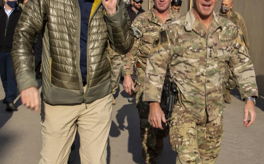 Then-acting Defense Secretary Christopher Miller, left, walks with Gen. Scott Miller in Kabul, Afghanistan, Dec. 22, 2020. Gen. Miller became the longest-serving commander of American and NATO forces in Afghanistan on March 5, 2021.