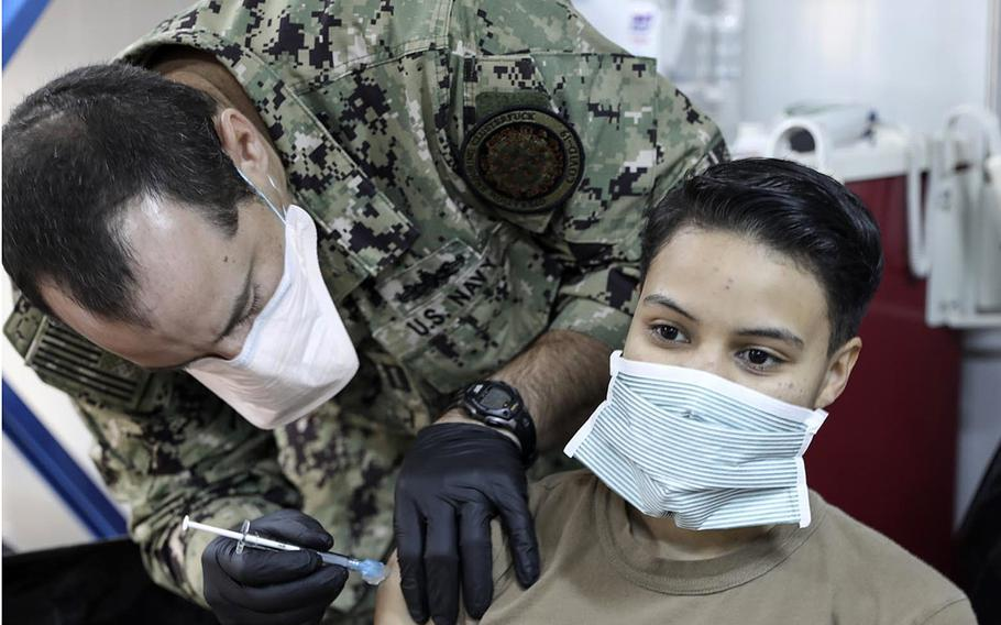 Petty Officer 3rd Class Diana Elston, with the Navy's expeditionary medical unit, receives the coronavirus vaccine at Erbil Air Base, Iraq. in January 2021.