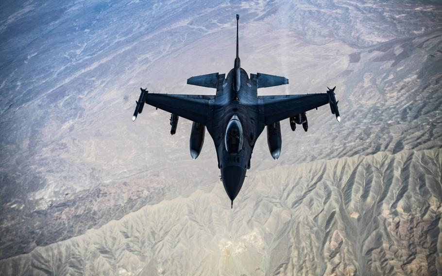 A U.S. Air Force F-16C Fighting Falcon flies over Afghanistan in 2018. The U.S. conducted airstrikes against Taliban fighters in southern Afghanistan this week after the insurgents launched multiple attacks on Afghan government forces, a U.S. military spokesman said March 17, 2021.