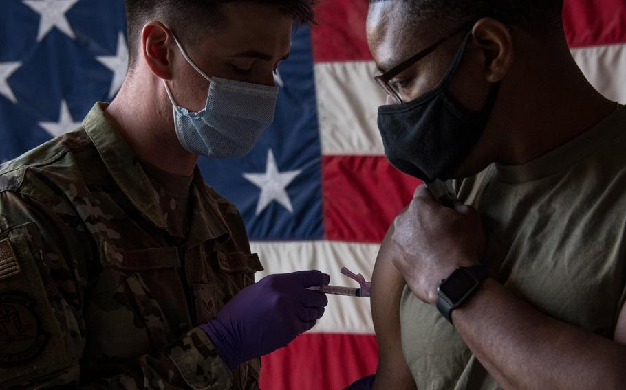 A medical airman at Al Udeid Air Base, Qatar administers a coronavirus vaccine in an undated photo. U.S. Central Command has shipped both the Moderna and Johnson & Johnson vaccines to the Middle East and expects 26,000 more Johnson & Johnson doses by the end of March, officials said.