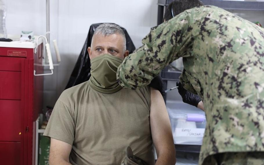 U.S. Army Col. Scott Desormeaux receives a coronavirus vaccine at Erbil Air Base, Iraq on Jan. 18, 2021. U.S. Central Command has shipped both the Moderna and Johnson & Johnson vaccines to the Middle East and expects 26,000 more Johnson & Johnson doses by the end of March, officials said.