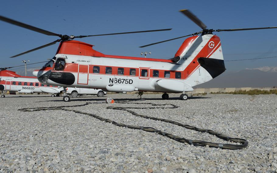 A V-107 helicopter waits to move cargo from Bagram Airfield, Afghanistan, in December 2016. An error by the U.S. military meant some coalition partners, who are supposed to pay back the cost of helicopter transportation, got free rides for three years, says a March 22, 2021, report by the Defense Department Inspector General.