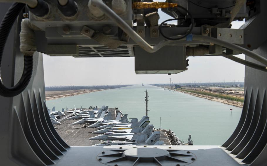 The aircraft carrier USS Dwight D. Eisenhower transits the Suez Canal, April 2, 2021. The canal was blocked for six days when a commercial ship ran aground last month.